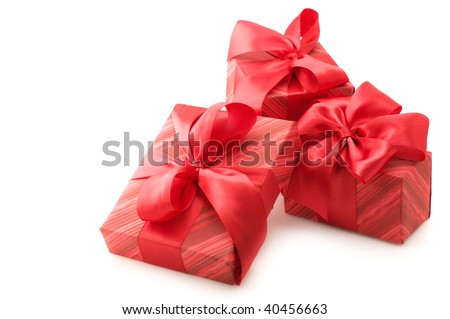 Three red gifts with satin bows isolated on white background.