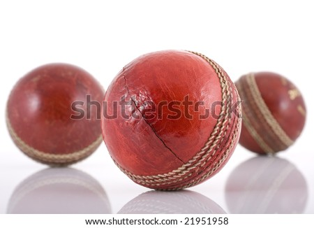 Three red leather cricket balls isolated on white - stock photo