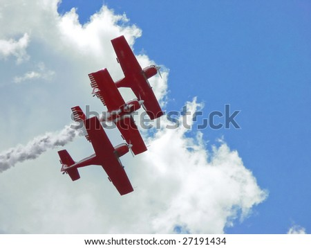 Three red planes on air show - stock photo