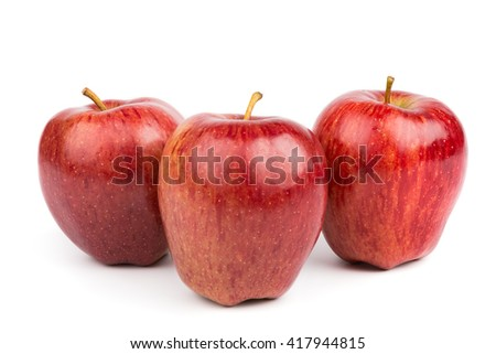 Three red ripe apples isolated on white background. Beautiful