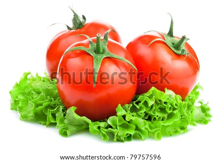 Three Red Ripe Tomatoes and lettuce on White background - stock photo