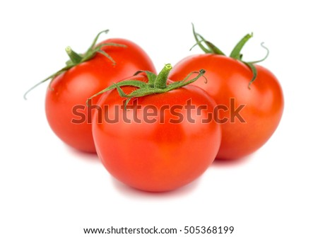Three red ripe tomatoes isolated on white background