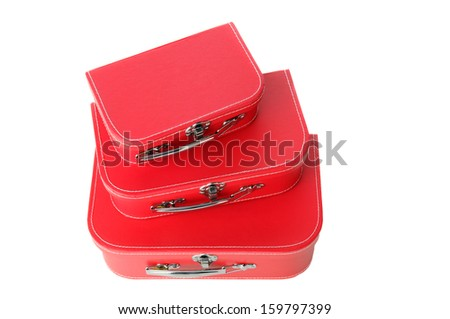 Three red suitcases stacked isolated on a white background. Shot from a high angle