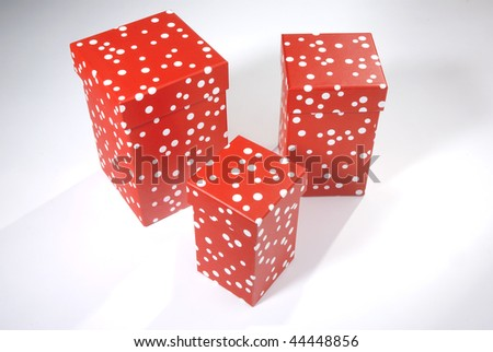 Three red Valentine boxes w white spots