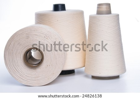 Three reels of the white rouge thread - stock photo