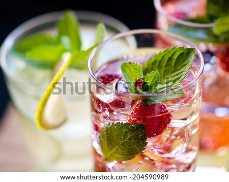 Three refreshing cocktails with raspberry, lime and mint - stock photo