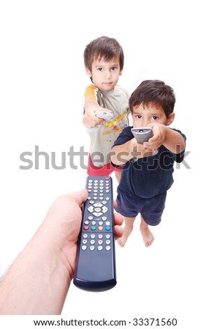 Three remote control used by father and two boys - stock photo