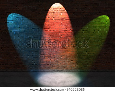 Three RGB spot lights on old brick wall - stock photo