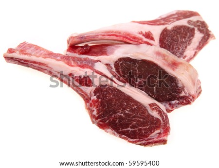 Three rib chops of lamb, isolated on a white background - stock photo