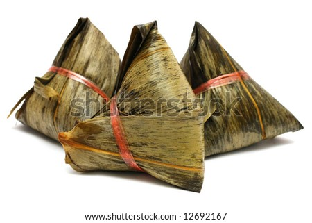Three rice dumplings (Chinese traditional food) on white background. - stock photo