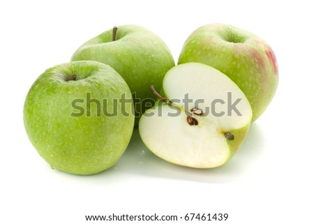 Three ripe and half green apples. Isolated on white - stock photo