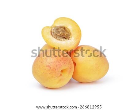 three ripe apricot fruits one half sliced isolated - stock photo