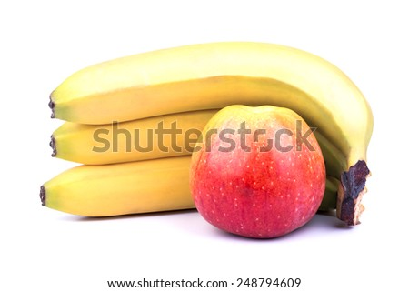 Three ripe banana and red apple on a white background