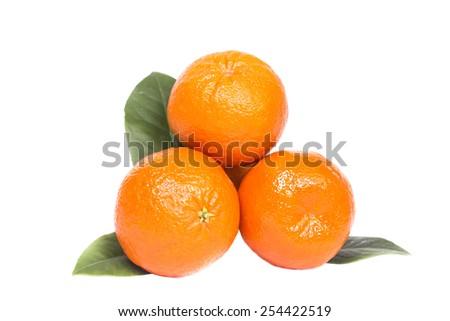 Three ripe fresh tangerine whole - stock photo