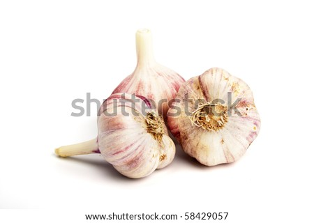 Three ripe garlics over a white background - stock photo