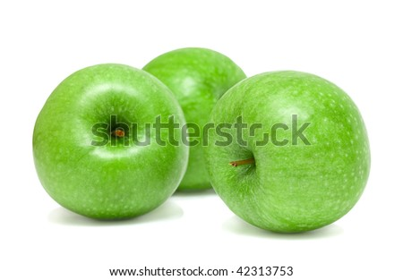 Three ripe green apples. Isolation. Shallow DOF.