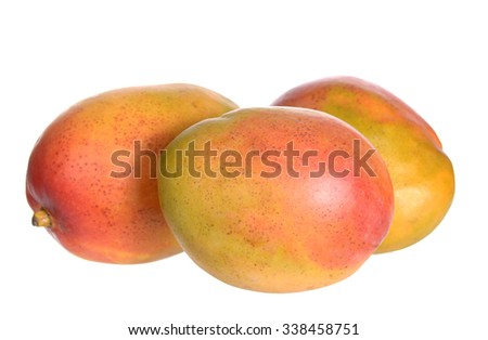 three ripe Mexican mango isolated on white  - stock photo