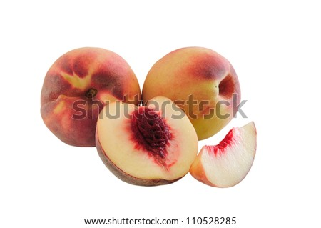 Three ripe peaches cut one of them photographed against a white background