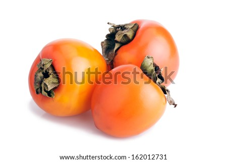 Three ripe persimmons isolated on white background - stock photo