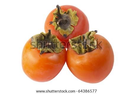 Three ripe persimmons isolated over white background (macro shot) - stock photo
