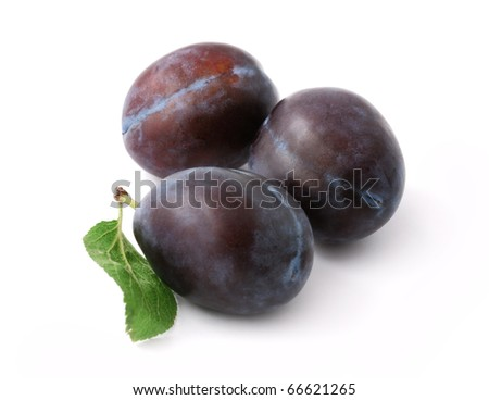 Three ripe plums isolated on white background - stock photo