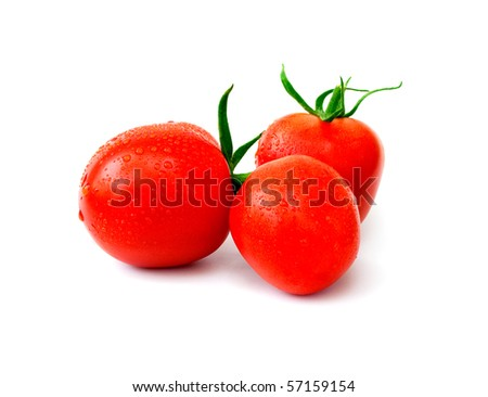 Three ripe red tomatoes with drops of water on a white background - stock photo