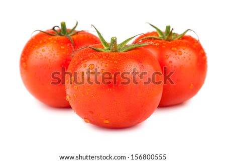 Three ripe red tomatoes with water drops isolated on white background - stock photo