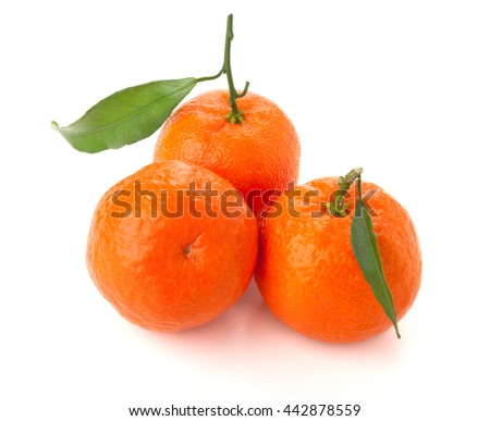 Three ripe tangerines with leafs. Isolated on white - stock photo