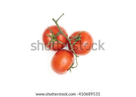 Three ripe tomatoes on a white background - stock photo
