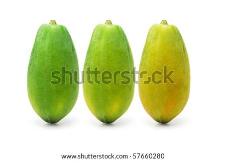 Three ripening papaya fruits on white background - stock photo