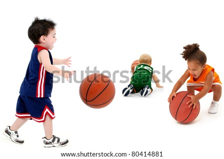 Three rival teams with balls in uniform over white. Toddler boy and girl child basketball players.