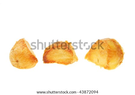 Three roast potatoes isolated on white - stock photo