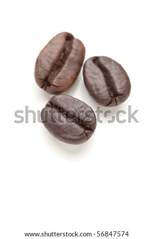 Three Roasted Coffee Beans Isolated on White with Narrow Depth of Field. - stock photo