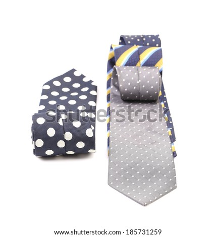 Three rolled multi-colored tie. Isolated on white background. - stock photo