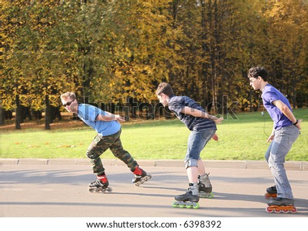 three rollers in the motion - stock photo