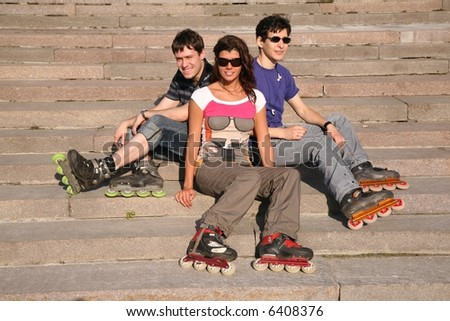 three rollers sit on the stairs - stock photo