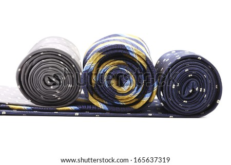 Three rolls of multi-colored tie. Isolated on a white background. - stock photo
