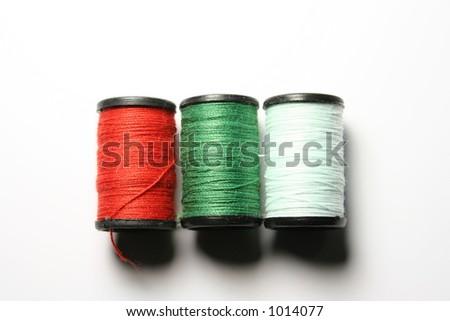 Three rolls of thread. - stock photo