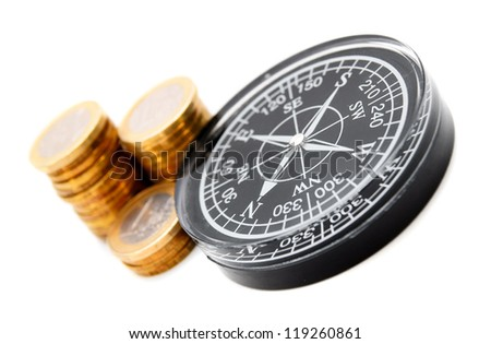 Three rouleaux. A black compass. - stock photo