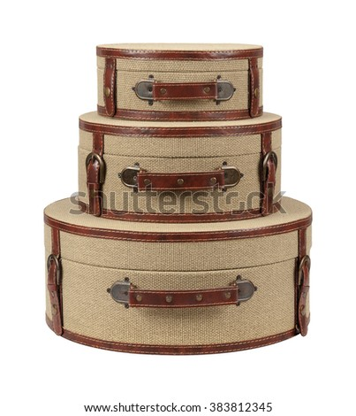 Three Round Deco Burlap Suitcases. The suitcases are stacked one on top of the other. The image is a cut out, isolated on a white background.