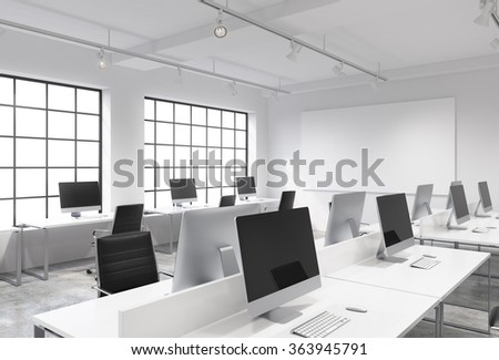 Three rows of computer tables in a light modern open space office, one of them along the window. Big blank screen on the wall.  3D rendering. - stock photo