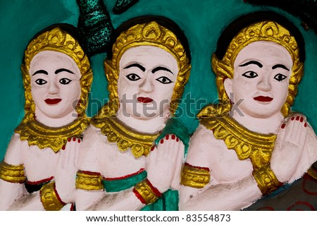 Three royal female servants as low relief decoration art object in Thai monastery - stock photo