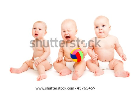 Three sad babies in diapers, isolated - stock photo