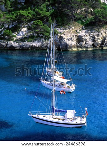 Three sailboats just of the cost of Minorca, Spain - stock photo