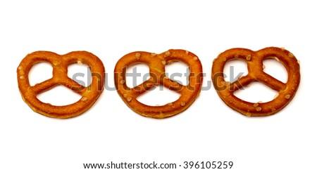 Three salted pretzels on white background  - stock photo