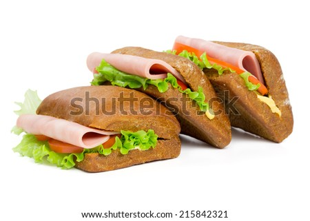 Three sandwiches with ham isolated on white