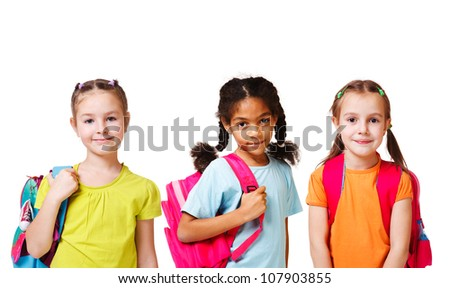 Three school aged girls with backpacks, over white