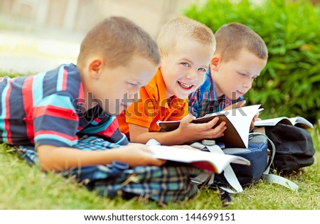Three schoolboys studying together after school. - stock photo