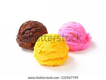 Three scoops of ice cream on white background  - stock photo