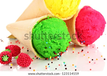 Three scoops of lemon, strawberry and kiwi ice cream in the waffle cones decorated with sprinkles - stock photo